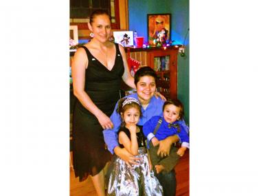 Angelica Lopez, standing, with her partner, Claudia Mercado, and their daughter, Isabel, and son, Indigo.