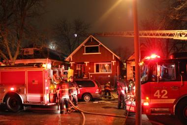 A neighboring house on the 8800 block of South Parnell Avenue in Auburn Gresham caught fire from the radiant heat of a blaze next door early Tuesday morning. The fires were out by about 4:30 a.m.