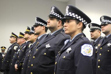 Chicago police officers wait to receive awards during a ceremony Tuesday.