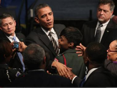 President Barack Obama greets students and guests after speaking during a visit to Hyde Park Academy High School on February 15, 2013 in Chicago, Illinois. This would be the final stop of a three-state tour to promote the agenda from his State of the Union Address.