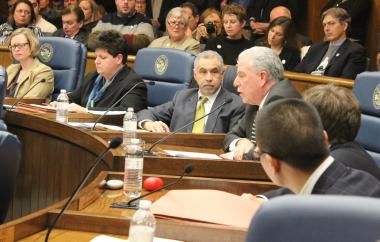 Chairman Rafael Leon listens to Commissioner Andrew Mooney make the economic case against preserving Prentice.