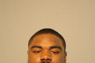Roosevelt Hartman, of the 160 block of North Laramie Avenue, is charged with pinning a Chicago police officer between a minivan and a squad car.