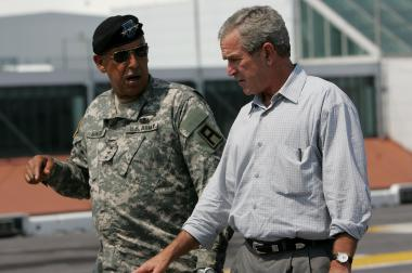 U.S. President George W. Bush (R) talks with U.S. Army Lt. General Russel Honore on the flight deck of the USS Iwo Jima September 20, 2005 in New Orleans, Louisiana.