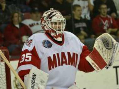 Miami University goalie Ryan McKay wears a mask created by Marist High School graduate and Ashburn native Don McClelland.
