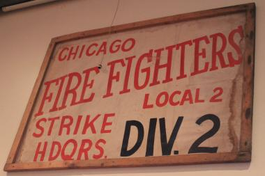 A poster from the 1980 Chicago firefighters strike hangs above the door at the North Side Fire Brigade.