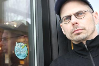 Adam Snow, general manager of Beans & Bagels, stands by the shop's pledge to eliminate its use of styrofoam.