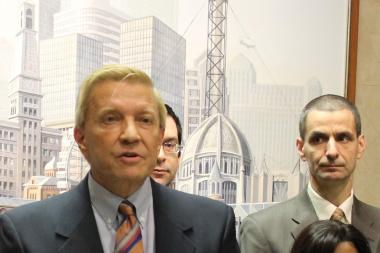 Aldermen Bob Fioretti and Nick Sposato say they're considering legal action to stop the new city ward map from taking effect before the next election.