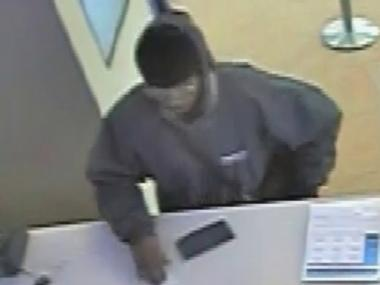 The FBI is looking for this man in connection to a downtown bank robbery on Thursday, March 14, 2013.