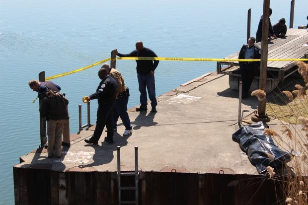 Police pulled a man's body from Jackson Park Harbor Thursday, authorities said.