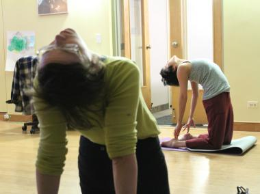 Joanna Quealy leads students during a recent yoga class inside Unity Center.