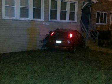 One person was injured after a car crashed into a house in Jefferson Park Friday night.