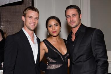 (L-R) Jesse Spencer, Monica Raymund and Taylor Kinney attend NBC's 'Chicago Fire' premiere at the Chicago History Museum on October 2, 2012 in Chicago, Illinois. (Photo by Daniel Boczarski/Getty Images)
