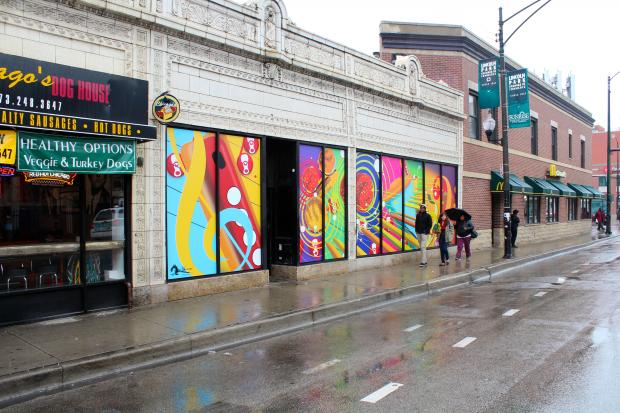 The owner of Chicago's Dog House comissioned a DePaul University student to create a mural along Fullerton.