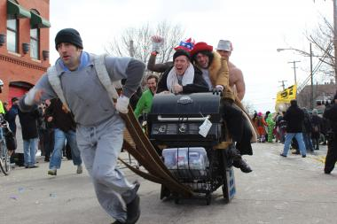 "The 8th annual ""Chiditarod"" was held Saturday in the city's Wicker Park and Ukrainian Village neighborhoods. Teams of five decorated shopping carts stuffed with food and raced from bar to bar. Money raised by event goes to fighting hunger and promoting food sustainability in Chicago."
