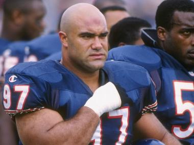 Chris Zorich, a former Chicago Bears defensive tackle, was indicted Thursday on charges of federal tax evasion