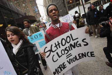 Students march through the Loop protesting the city's plan to close more than 50 elementary schools on March 25, 2013.