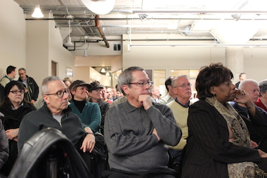Hundreds attended a South Loop community meeting Thursday night to discuss development of the city's Motor Row District, including talk of a possible DePaul Arena and a new access road to Lake Shore Drive.