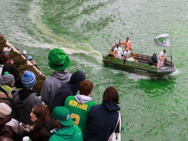Chicago Journeyman Plumbers dyed the Chicago River green March 16, 2013 for St. Patrick's Day weekend as part of a tradition that is more than 40 years old. The dye begins as an orange color.