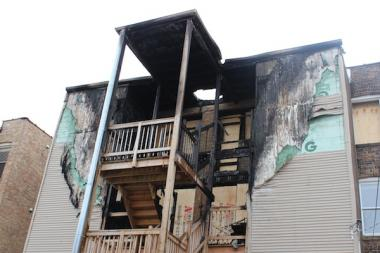 A Lakeview fire displaced 13 residents Sunday night. Monday morning, the sun lit up the damage to the top two floors of the building in the 1200 block of West Roscoe Avenue.