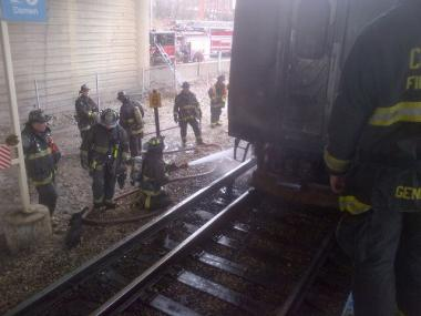 Firefighters extinguish a small fire in a Blue Line car near the Medical District stop.