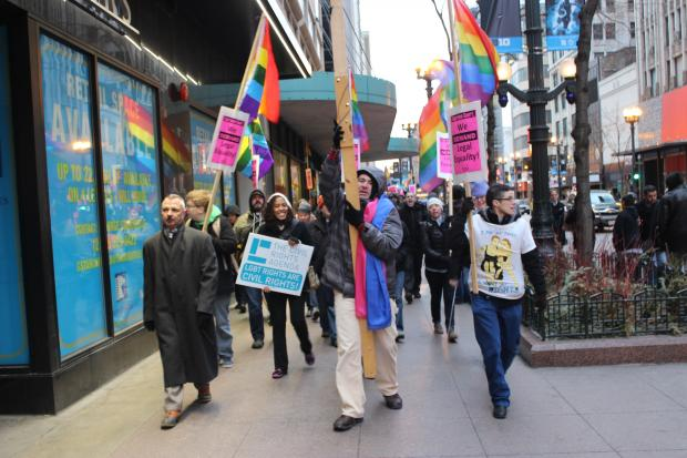 Allies and gay rights advocates marched in the Loop Monday night hours ahead of landmark Supreme Court hearings that could affect the state of gay rights nationwide.