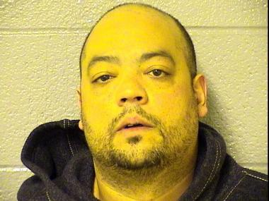 Hector Santiago, 41, ran from the scene after he crashed his girlfriend's car into police in Irving Park, court records show.