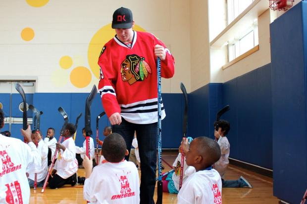 U.S. Rep. Mike Quigley teamed up with Chicago Blackhawks winger Jimmy Hayes to teach a youth hockey clinic Wednesday at the St. Vincent de Paul Center.