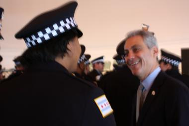 Mayor Rahm Emanuel greets new Chicago Police officers, including Kendra Archer, before their graduation ceremony Tuesday at Navy Pier.