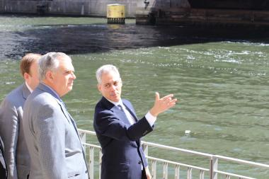 U.S. Transportation Secretary Ray LaHood (from l.) and Mayor Rahm Emanuel discuss plans to complete the Chicago Riverwalk Thursday.