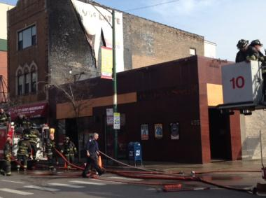 Fire crews work the scene at Old Town Social, 455 W. North Ave., after a small fire on Sunday, March 17, 2013.