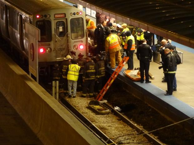 Crews worked to extract a person pinned beneath a Red Line train at the 87th Street stop on Thursday, March 14, 2013.