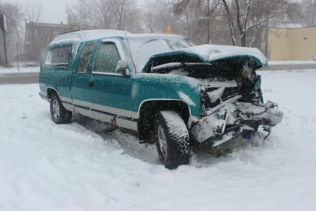 Three people were hurt when a pickup truck collided with a fire engine Tuesday morning in Canaryville.