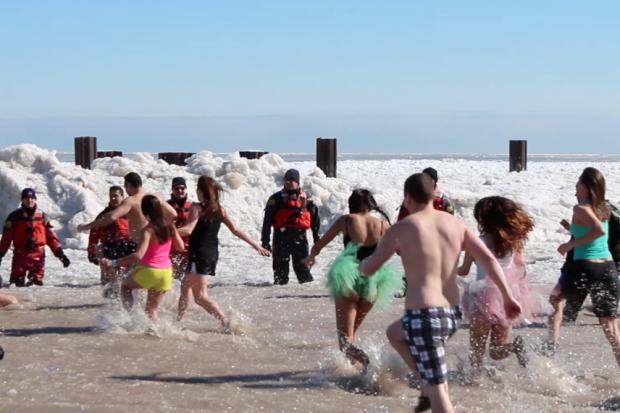 "Thousands of people took to the frigid Lake Michigan water Sunday morning for the ""Polar Plunge."""