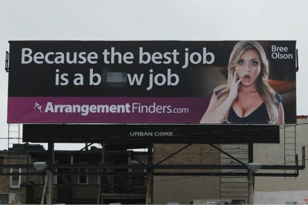 A racy billboard removed from the River North neighborhood has reappeared in Avondale.
