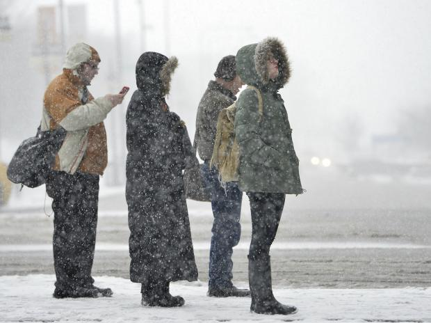 Flights were cancelled and a number of schools were closed in anticipation of a snowstorm that is expected to dump up to 8 inches of snow on Chicago.