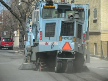 A street sweeper does some pre-season sweeping on Kimball Avenue in Albany Park.