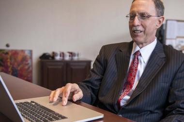 "John W. Boyer, dean of the College, hits the ""send"" button on his computer Friday to let 2,676 applicants know they were accepted to the University of Chicago as undergrads for next year."
