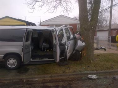 "A ""special needs transport"" van hit a tree in the 11400 block of South May Street Monday morning, sending nine people to area hospitals."