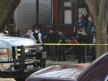 A man is transported from a home in Englewood after Monday afternoon's shooting.