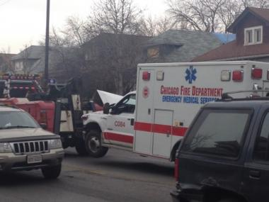 Two medics were injured when a Chicago Fire Department ambulance collided with a school bus on the Northwest Side Saturday morning.