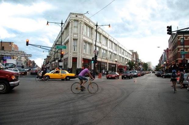 A cyclists crosses the Milwaukee-Damen-North intersection in Wicker Park.