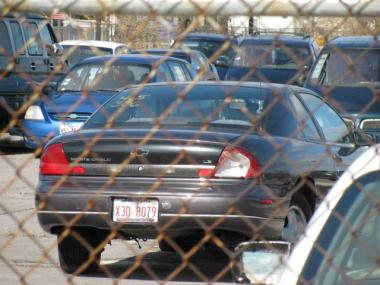The car that amassed $105,000 in Chicago parking tickets sits in O'Hare Airport auto pound last November.