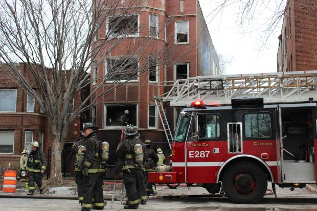 Firefighters issued a 'mayday' call after a stairwell collapsed as they were fighting a blaze at 9041 S. Muskegon Avenue Saturday morning.
