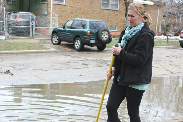 Residents cope with the aftermath of Chicago River Flooding, April 2013.