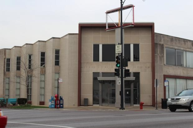 Mike Bousis, the owner of Cermark Fresh Markets, plans to tear down the former bank near Six Corners.