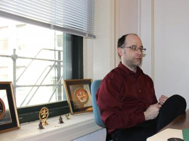 Brian Keigher in his office at Kalapriya's new home in the Fine Arts Building.