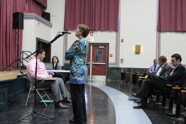 Uplift Community High School teacher Karen Zaccor speaks at an April community meeting in support of keeping Stewart school open as a school.