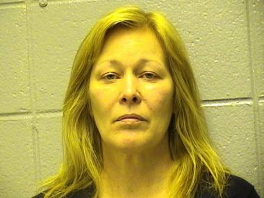 Kathleen Barth, 56, was charged with stealing more than $2.1 million from the chemical company she managed, officials said.