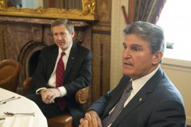 Sens. Mark Kirk (R-Ill.) and Joe Manchin (D-W.Va.), ditch their caucus lunches every Thursday and eat together in bipartisan fashion.