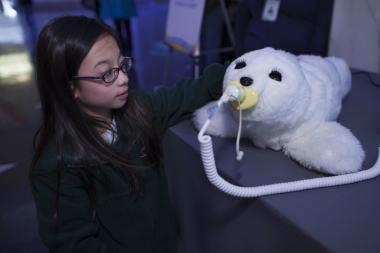 Paro, a robotic seal that can sense and react to human emotions, will be one of more than 20 robots on display starting Saturday at the Museum of Science and Industry for Robotics Week.